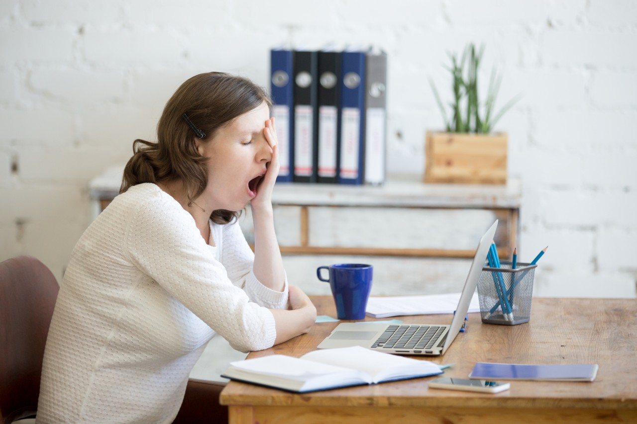 bigstock-Sleepy-Young-Worker-Woman-Yawn-143681474